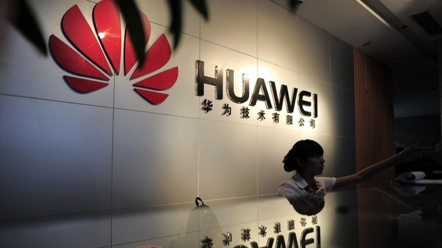 A receptionist is seen behind the counter of a Huawei office in Wuhan, central China's Hubei province, on October 8, 2012.