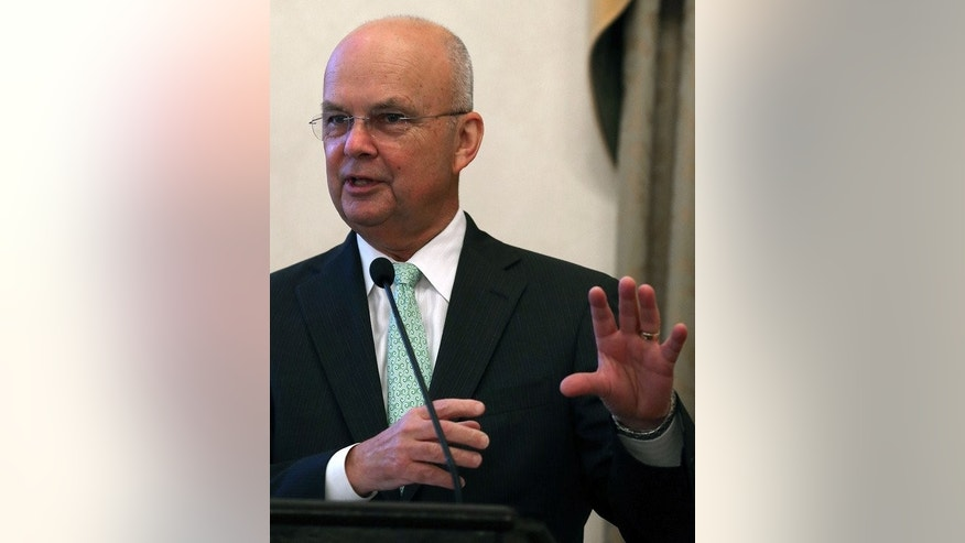 """Michael Hayden, former Central Intelligence Agency and National Security Agency Director, pictured during a function in Washington, DC, on July 13, 2012. Speaking to the Australian Financial Review in a recent interview, Hayden said it """"goes without saying"""" that Chinese telecoms giant Huawei spies for Beijing."""