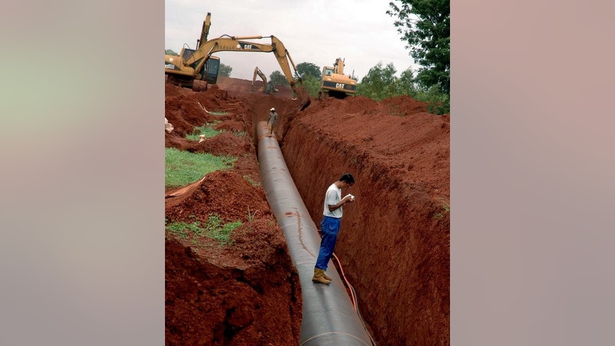 A gas pipeline under construction for Reliance Industries at Medak, 175kms from Hyderabad in 2007. The energy giant, controlled by India's wealthiest man Mukesh Ambani, said consolidated net profit rose 18.9 percent to 53.52 billion rupees ($896 million) in the three months ended June, from 45.03 billion rupees a year ago.