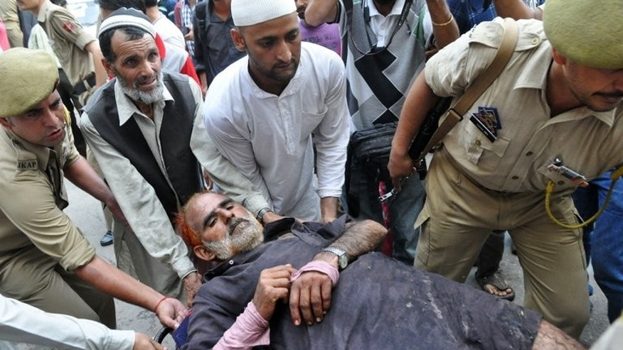 A Kashmiri man, injured after being shot by Indian Border Security Force soldiers, is carried to a hospital in Jammu on July 18, 2013. Shops, banks, schools and most government offices were closed in towns across the region, after a separatist leader called a three-day strike to protest Thursday's killings.