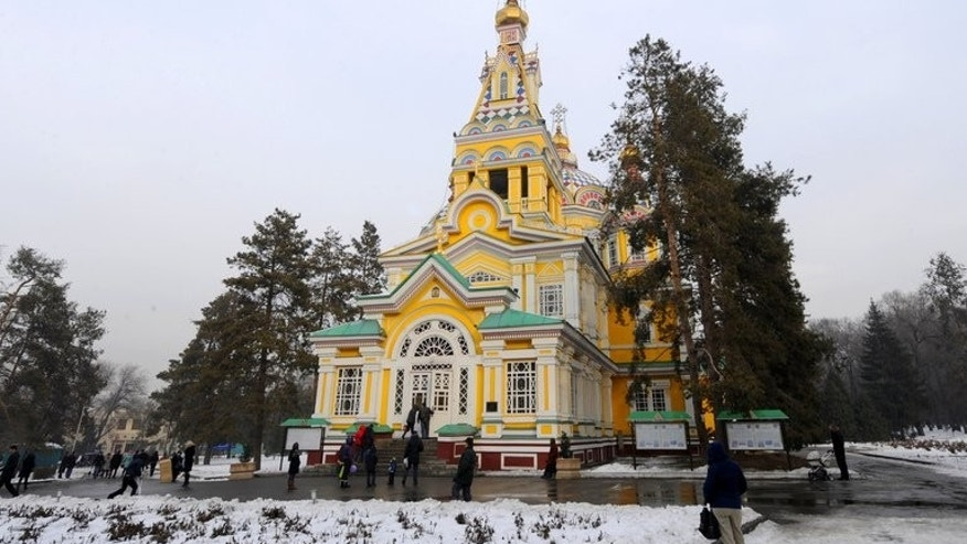 People walk in front of the Russian Orthodox Ascension Cathedral in Almaty on January 30, 2011. Kazakhstan has launched legal proceedings on suspicion of graft in a passport counterfeiting case against a wanted oligarch's wife who was expelled from Italy in May, officials said Friday.