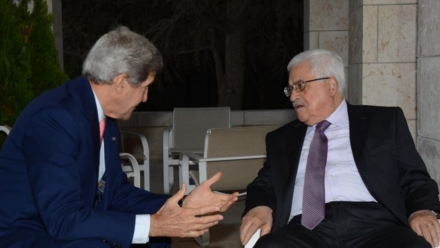 Palestinian leader Mahmud Abbas (right) meets US Secretary of State John Kerry in Amman on July 16, 2013. US Secretary of State John Kerry Friday met with chief Palestinian negotiator Saeb Erakat in a final push to get a peace bid back on track before heading home.