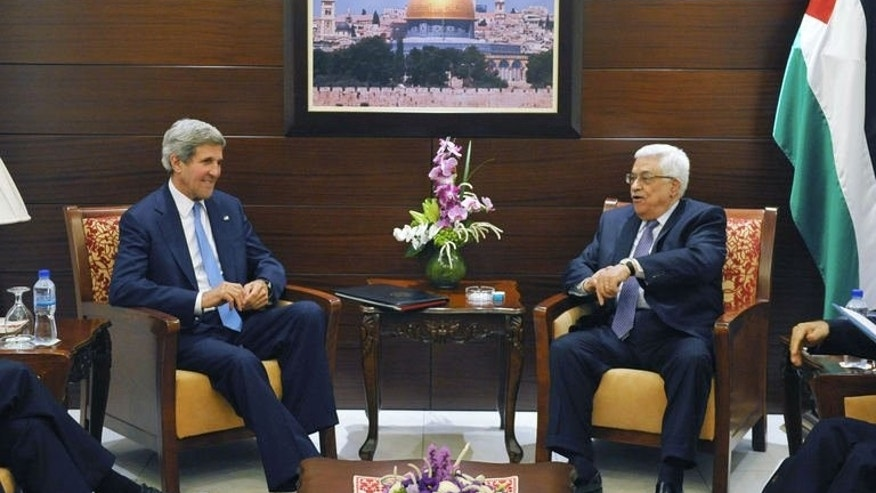 US Secretary of State John Kerry (L) meets with Palestinian president Mahmud Abbas on July 19, 2013 in the West Bank city of Ramallah. Kerry flew by helicopter to the West Bank from Jordan to meet Abbas as he battled to salvage his Middle East peace bid.