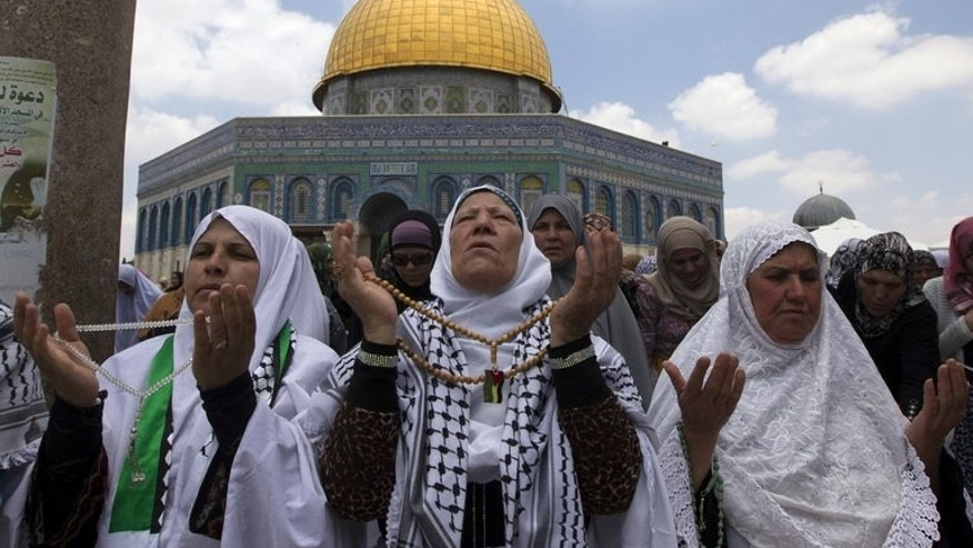 Palestinian women take part in Friday prayers during the holy Muslim month of Ramadan at the Al-Aqsa Mosque compound in Jerusalem on July 19, 2013. Some 155,000 Muslims attended prayers at Jerusalem's Al-Aqsa mosque compound on the second Friday of the Muslim fasting month of Ramadan, Israeli police said.