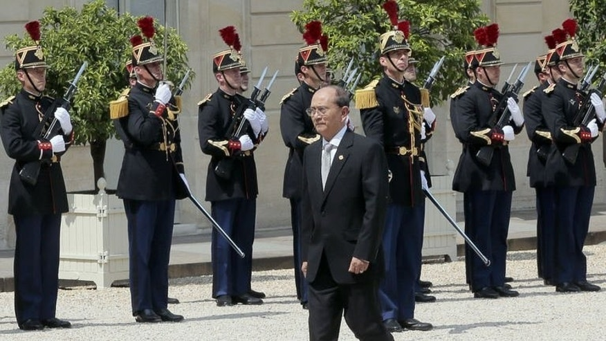 "Myanmar President Thein Sein passes by the French Republican Guards at the Elysee presidential palace on July 17, 2013 in Paris. Sein denied on Friday accusations of ethnic cleansing against Rohingya Muslims, saying the claims were part of a ""smear campaign"" against his government."