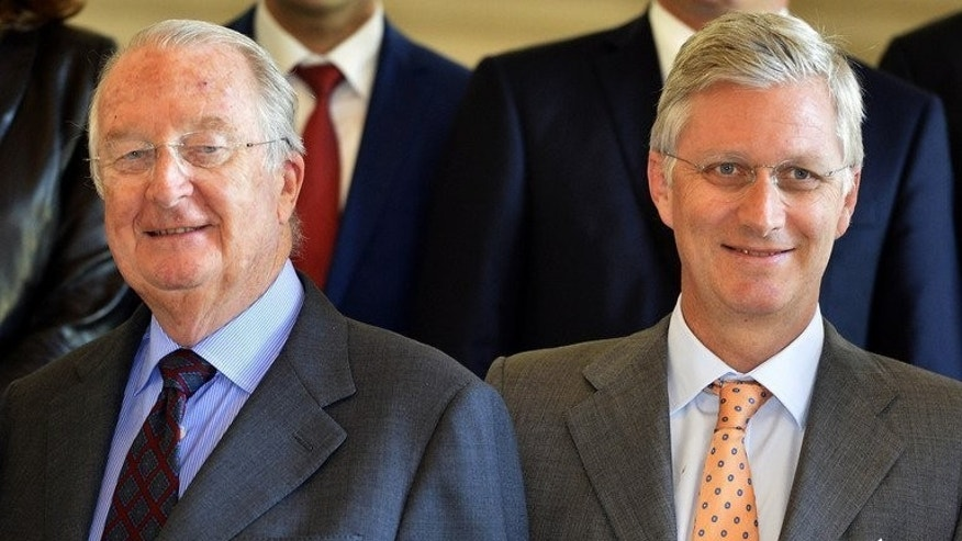 Belgium's King Albert II (R) and Crown Prince Philippe pose before a reception on July 8, 2013 at Laeken royal castle in Brussels. The easy-going style of the monarch, who abdicates Sunday in favour of his son Philippe, belies the power wielded by the sovereign in a country split by language, religion and history.
