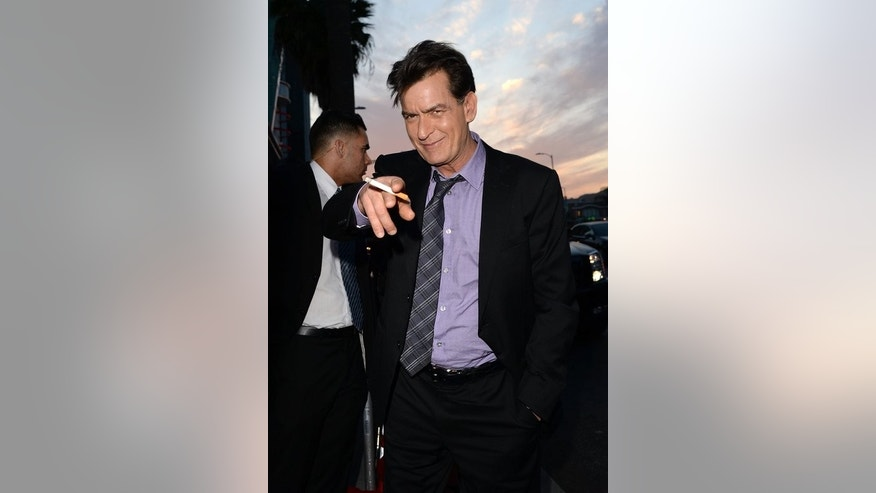 "Actor Charlie Sheen arrives for a movie premiere on April 11, 2013 in Hollywood. He starred in the US hit sitcom ""Two and a Half Men"" from 2003 to 2011 before being fired in March 2011 following public attacks on the show's creator."