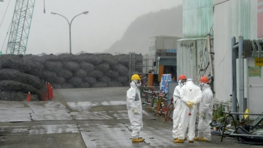 Workers take a break at Japan's Fukushima nuclear plant in Okuma on June 12, 2013. Around 2,000 people who have worked at the wrecked plant face a heightened risk of thyroid cancer, its operator says.
