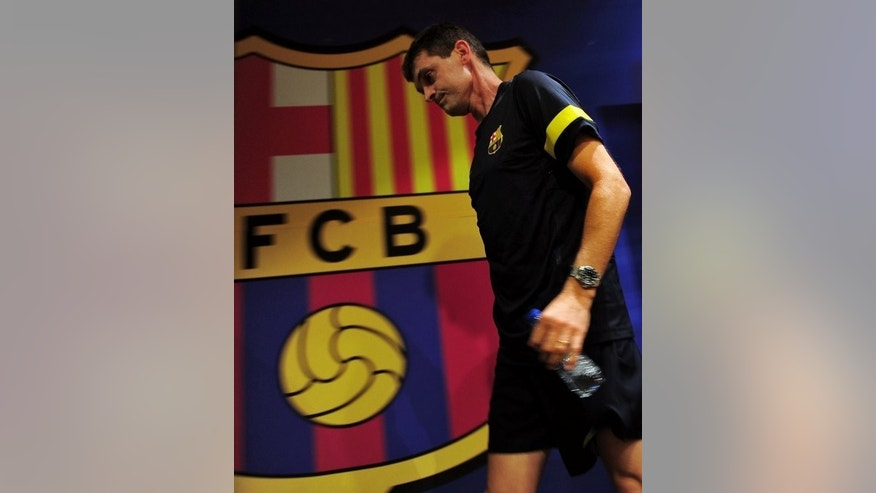 Barcelona's coach Tito Vilanova is leaving a press conference at the Camp Nou stadium in Barcelona, on September 18, 2012. After an amazing start to his first senior managerial role on the field as Barcelona made the best ever start to a Spanish league campaign, the club was rocked by the news in December last year that the cancer had reappeared.