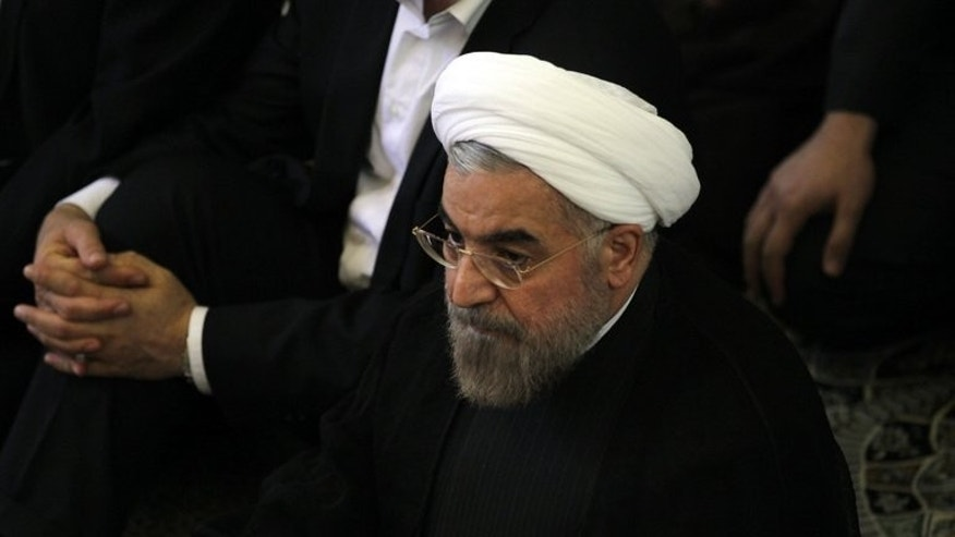 "Iranian president-elect Hassan Rowhani (C) attends the Friday prayer on July 12, 2013 in Tehran. World powers hope his election as president of Iran will provide fresh impetus and ""a change in tone"" in ongoing talks on the country's controversial nuclear programme."
