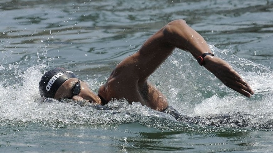Tunisia's Oussama Mellouli competes in the men's 5km open water swimming event in the FINA World Championships on July 20, 2013 in Port Vell in Barcelona. Mellouli won gold.