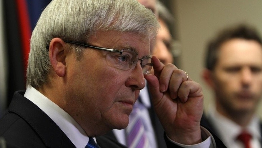 Australian PM Kevin Rudd talks to the media after announcing a policy on asylum seekers, in Brisbane, on July 19, 2013. Rudd announced that no more boatpeople will be resettled in Australia with all unauthorised arrivals to be sent to Papua New Guinea.