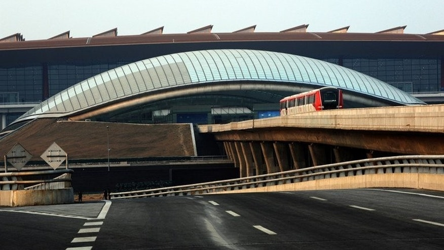 A train heads towards Terminal 3 at the Beijing International Airport on February 21, 2008. A man in a wheelchair has detonated a home-made explosive device outside an arrivals exit at Beijing's international airport, state media reported, injuring himself but no others.