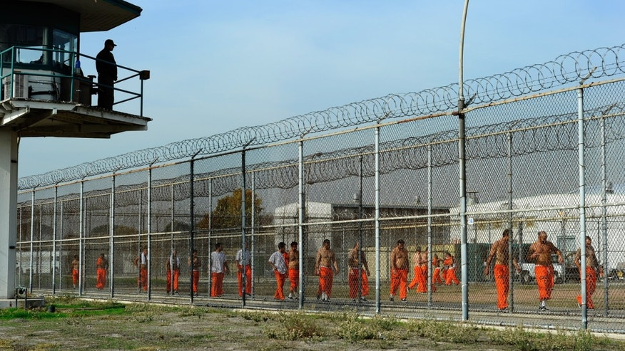 Inmates exercise at Chino State Prison in Chino, California.