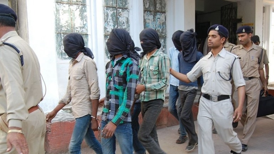 Indian police escort the gang-rape suspects to court in Datia, in central Madhya Pradesh state, on March 18, 2013. The six men accused of the rape and robbery of a 39-year-old Swiss tourist have been sentenced to life terms in prison.