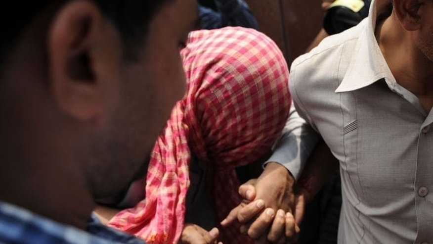 Indian police escort one of the suspects in the New Delhi rape case from the Juvenile Justice Board, on July 11, 2013. The verdict has been deferred to July 25.