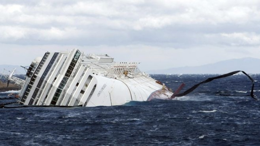 Feb. 1, 2012: Anti oil floating barriers are pushed by strong winds around the grounded cruise ship Costa Concordia off the Tuscan island of Giglio, Italy.