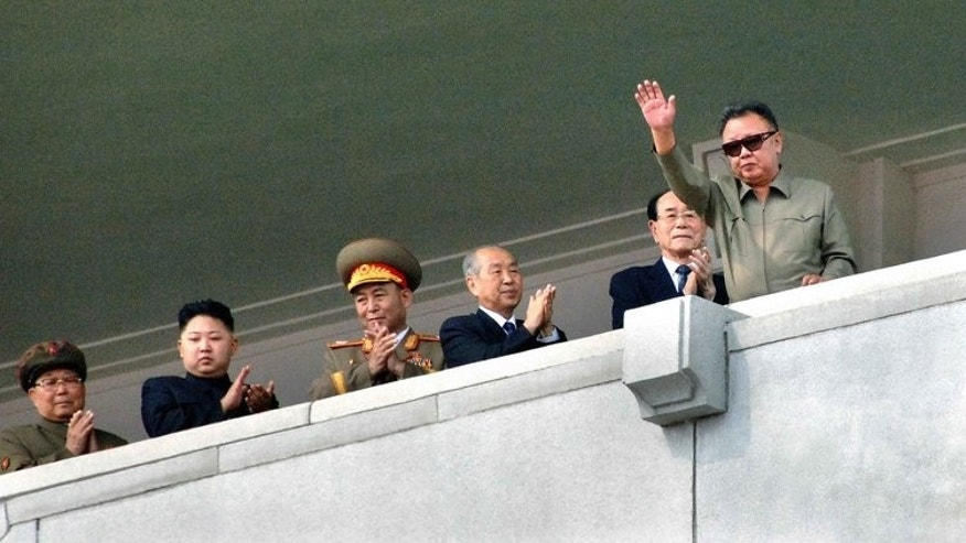 A picture released by North Korean state media shows then leader Kim Jong-Il (R) and his son Jong-Un (2ndL) during a military parade in Pyongyang in September 2011. North Korea has awarded the late Kim Jong-Il a new medal, official media said.