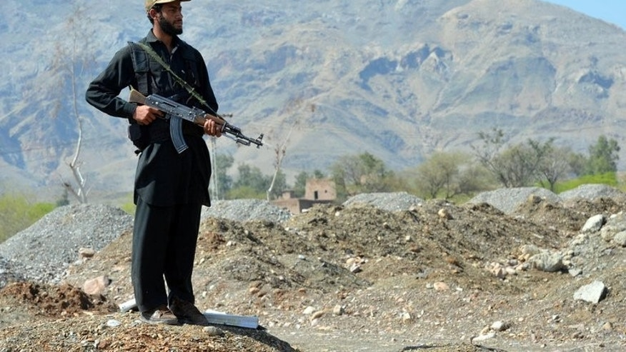 A Pakistani paramilitary soldier stands near a checkpoint in the Khyber tribal district, on March 15, 2013. At least 15 militants and four soldiers have been killed during clashes in a tribal district in northwest Pakistan, security officials tell AFP.