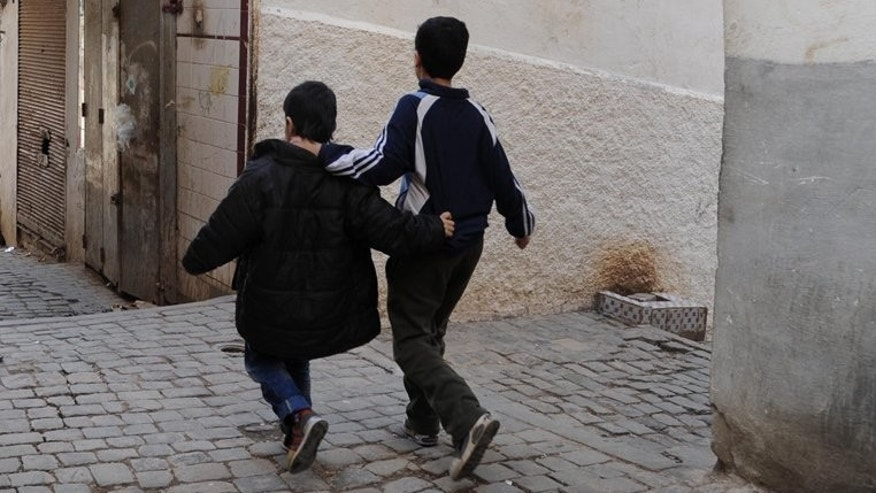 Children walk in a narrow street of the Kasbah of Algiers on March 22, 2013, in Algeria. The country's public prosecutor on Sunday demanded the death penalty for two men on trial for abducting and murdering two boys aged nine and 10, the news agency APS reported.