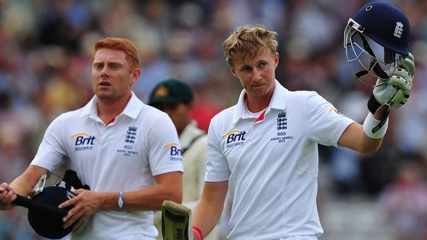 England's Joe Root (right) acknowledges the crowd as he leaves the field on the third day of the second Ashes cricket Test match against Australia Lord's in London, on July 20, 2013. Australia have been set a target of 583 to win the match as England declare their second innings on the fourth morning,