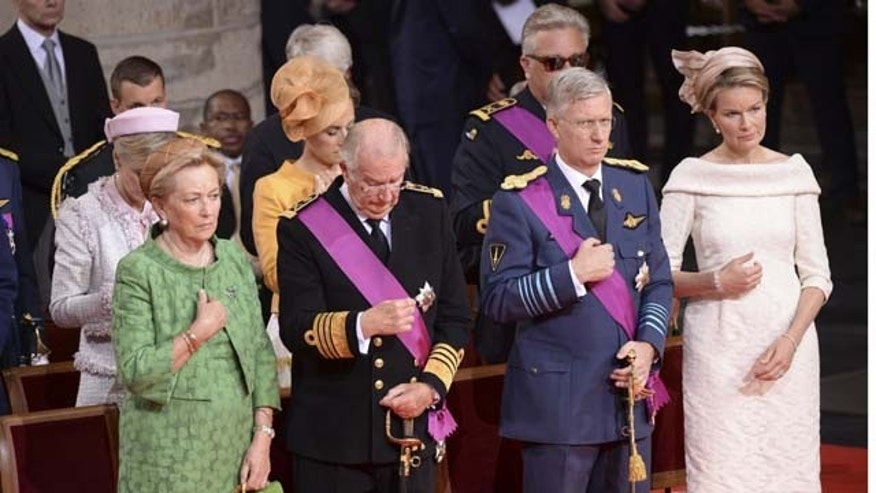 July 21, 2013: Royal family members from left front, Queen Fabiola, Queen Paola, King Albert II, Prince Philippe and his wife Princess Mathilde attend a church service at the St. Gudule cathedral in Brussels. (AP Photo)