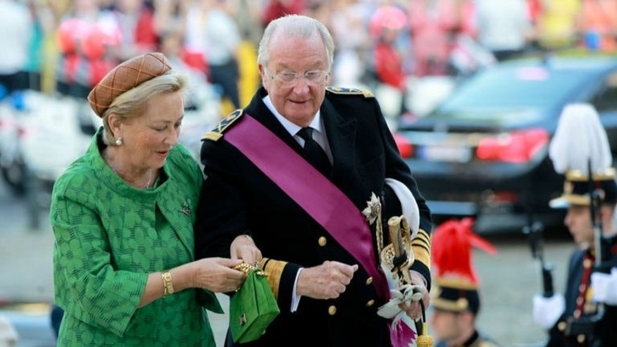 Queen Paola and King Albert II arrive for the Te Deum mass at the Saint Michael and St Gudula Cathedral in Brussels on July 21, 2013. Albert II has abdicated after 20 years as 'King of the Belgians' in favour of his son Philippe, who becomes the seventh monarch of a country deeply divided between its French- and Flemish-speaking halves.