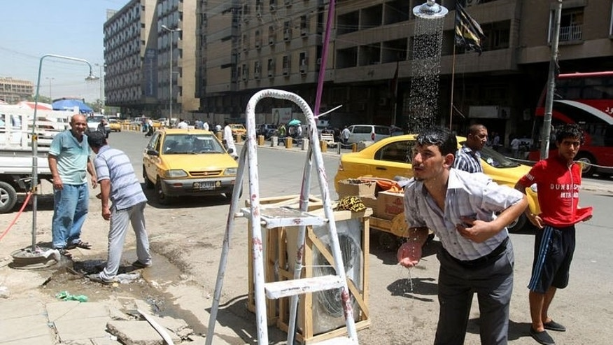 Showers are set-up along a street in Baghdad as temperature soar during the Muslim fasting month of Ramadan, on July 15, 2013.