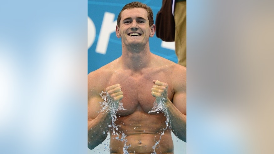 South Africa's Cameron Van der Burgh celebrates after breaking the world record the men's 100m breaststroke final swimming event at the London Olympic Games, on July 29, 2012. Van der Burgh, 25, is one of key South African hopefuls for success at the upcoming world championships, starting Sunday, in Barcelona.