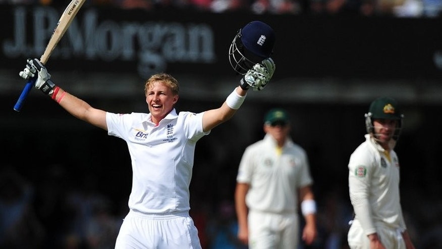 England's Joe Root celebrates after reaching his century during play on the third day of their second Ashes Test match against Australia, at Lord's cricket ground in north London, on July 20, 2013.