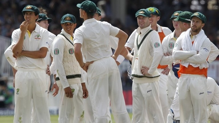 Australia's players wait for a referral decision on a possible catch by Australia's Steven Smith (2nd L) off the batting of England's Ian Bell which is later given not out, during play on the third day of their second Ashes Test match, at Lord's cricket ground in north London, on July 20, 2013.
