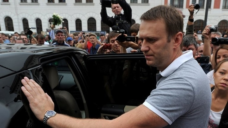 Russia's top opposition leader Alexei Navalny is surrounded by supporters upon his arrival in Moscow, on July 20, 2013. Navalny is preparing his campaign to challenge the pro-Kremlin elite in Moscow mayoral elections after returning home to a hero's welcome following his release from prison.