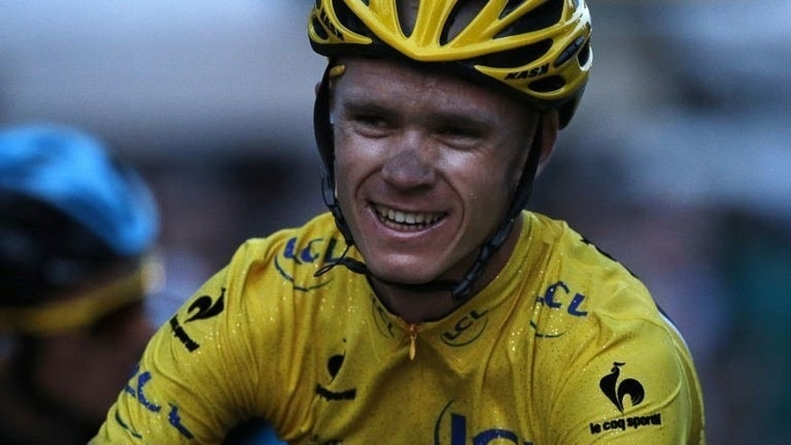 Britain's Christopher Froome, 2013 Tour de France winner, smiles after crossing the finish line in Paris, July 21, 2013. He made an amazing journey from the dirt roads of Kenya to success in the world's greatest bike race.