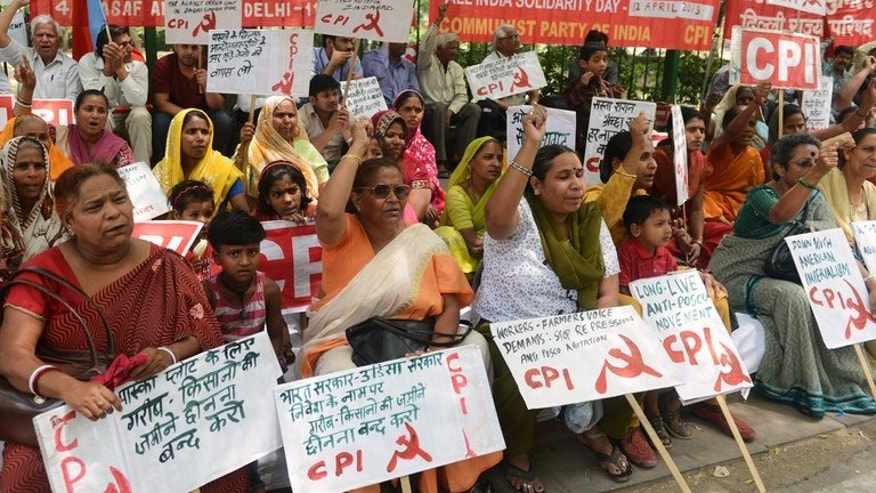 Hundreds of supporters from India's left parties demonstrate against farmland being converted into an industrial development area, during a protest against the American-Korean Posco steel plant, in New Delhi, on April 12, 2013.