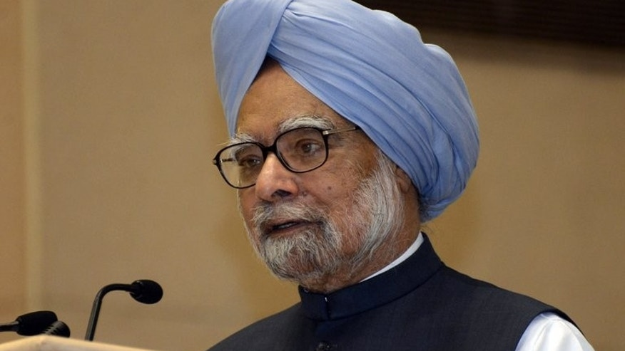 "Indian Prime Minister Manmohan Singh addresses the audience during annual meeting of Industry Chamber Assocham, in New Delhi, on July 19, 2013. Singh urged investors to ""remain optimistic"", while acknowledging that the country would register lower annual growth than expected in 2013-14."