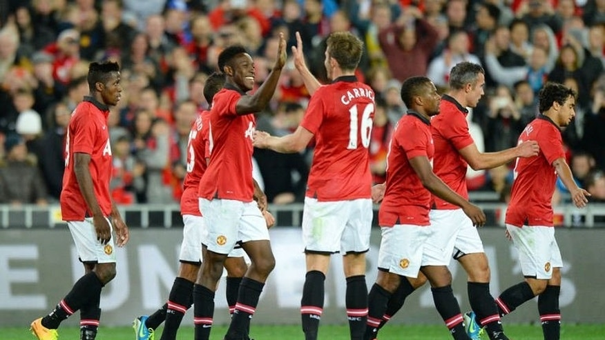"Manchester United celebrate a goal against Foxtel A-League Allstars in Sydney on July 20, 2013. New Manchester United manager David Moyes says he is looking forward to playing ""mind games"" with Jose Mourinho as Chelsea step up their interest in unsettled striker Wayne Rooney."