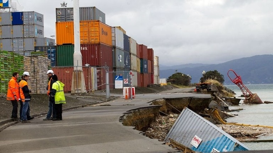 An empty shipping container sits in the harbour where the land fell into the sea at the Port Wellington Container terminal caused by yesterdays earthquake on July 22, 2013.