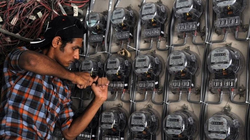 A technician from the Karachi Electric Supply Corporation (KESC), Pakistan's largest city's power supply company, checks electricity meters at a residential building in Karachi, on May 13, 2010. Pakistan's power sector has been crippled by years of corruption and underinvestment, leaving people to struggle through blackouts of up to 20 hours a day in the blistering heat of summer.