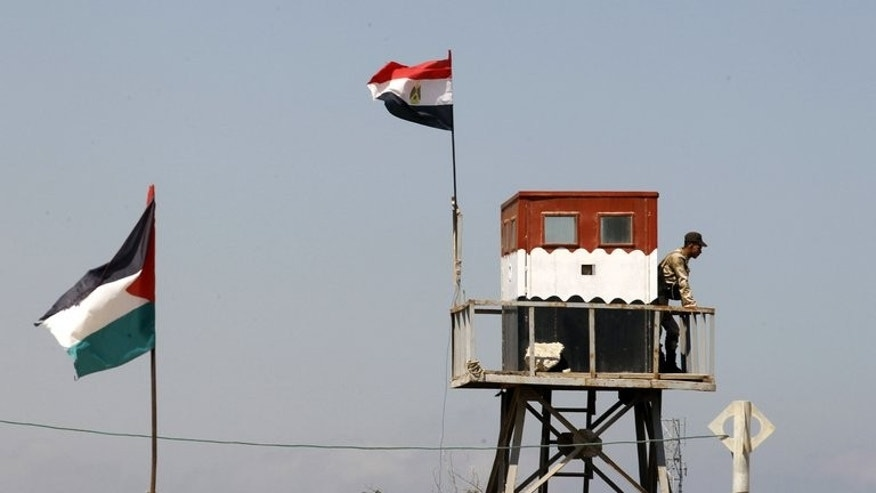 An Egyptian soldier standing on top of a watch tower on the Egyptian side of the border with the Gaza Strip, on July 5, 2013 Gunmen have killed two Egyptian soldiers and a policeman in three separate attacks in the restive Sinai peninsula, which borders Israel, security and medical sources told AFP.