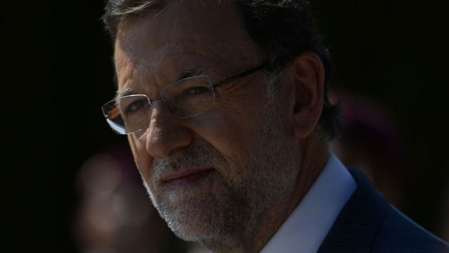 Spanish Prime Minister Mariano Rajoy looks on during a press conference at the Moncloa Palace in Madrid, on July 15, 2013. Rajoy -- under fire over a corruption scandal -- faced more pressure as a poll indicated nearly nine in 10 Spaniards thought he should explain himself in parliament.