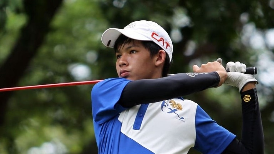 Thailand's Phachara Khongwatmai plays during the Singha Hua Hin Open on the ASEAN PGA Tour on July 21, 2013. The teenager became the youngest male to win a major professional golf tournament, organisers said, with a stunning display that left players twice his age trailing in his wake.