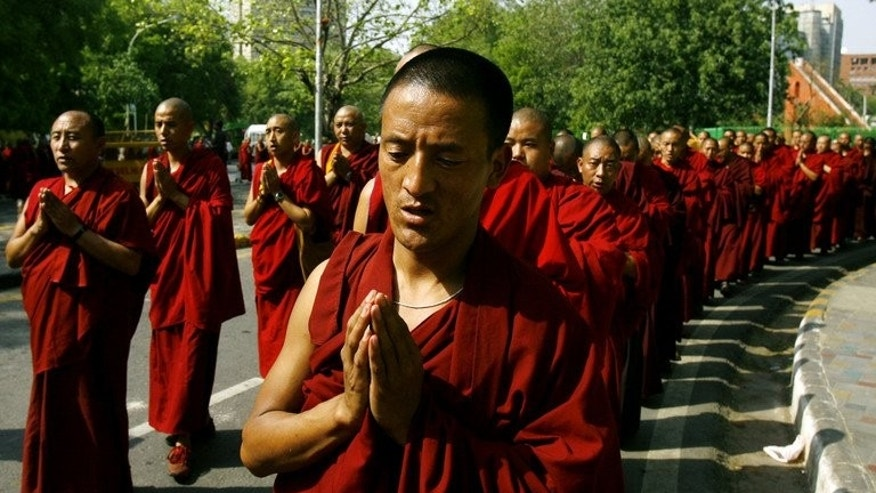 This file photo shows Tibetan monks in exile praying during a protest against alleged human rights violations in their home-land, in New Delhi, on April 11, 2008. A Tibetan monk died on Saturday, after setting himself on fire in southwest China, in the first such protest for more than a month.