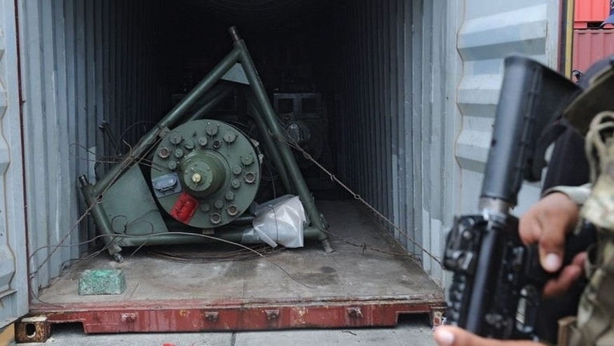 A Panamanian soldier stands guard near a container from the North Korean Chong Chon Gang vessel, where an ageing Soviet-built radar control system for surface-to-air missiles was found, at the Manzanillo Port in Colon, Panama, on July 17, 2013. UN sanctions experts plan to travel to Panama to inspect the shipment on August 5.