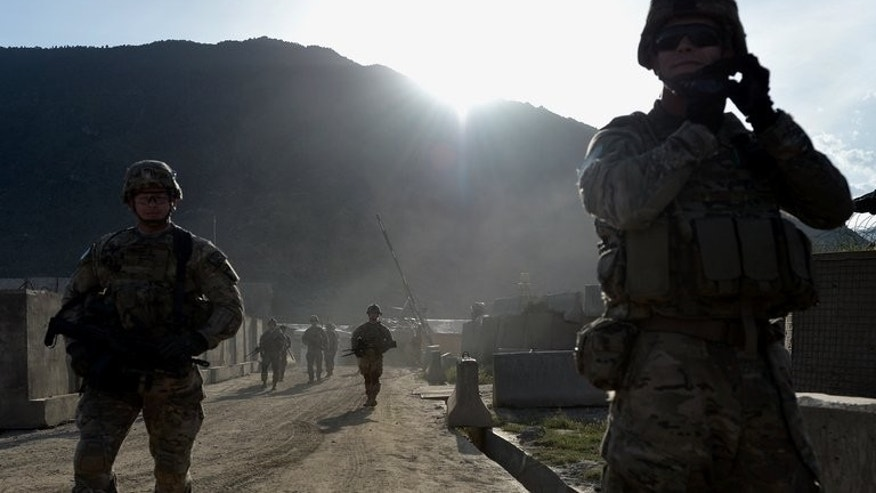 US soldiers march from their base situated in the Watahpur District of Kunar province, on April 18, 2013. The Afghan president told the top US military commander that he is ready in principle to let American troops stay in Afghanistan beyond 2014, a month after suspending security talks.