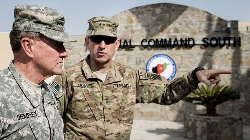 """US General Martin Dempsey (left) and Major General Robert """"Abe"""" Abrams arrive at the Zagabad Forward Operating Base in Afghanistan, on Decemeber 16, 2012. The Afghan president has told the top US military commander that he was ready in principle to let American troops stay in Afghanistan beyond 2014, a month after suspending security talks."""