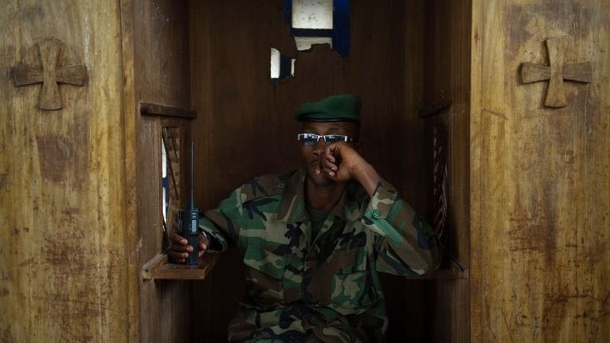An M23 soldier sits in a confession booth during a session to teach rebel movement's values in DR Congo on July 20, 2013. The latest clashes in the central African country's mineral-rich but conflict-torn east broke four days of relative calm.