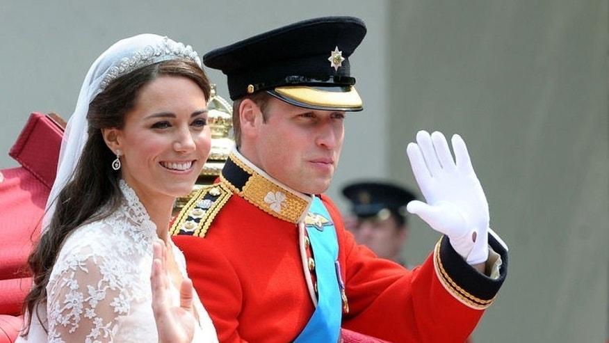 Britain's Prince William and his wife Catherine head to Buckingham Palace after their wedding in London on April 29, 2011. The birth of the couple's first baby will be the culmination of their relationship which began as friendship, blossomed into love and saw them marry in a fairytale wedding.
