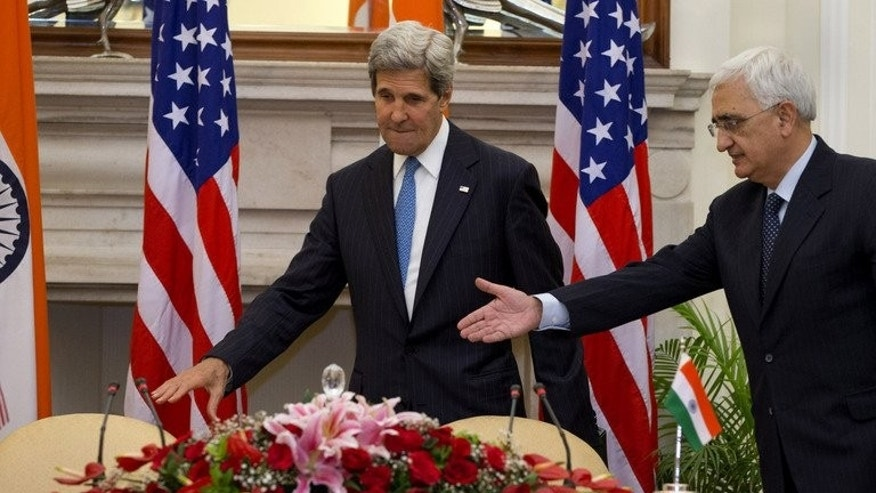 US Secretary of State John Kerry (L) and Indian Foreign Minister Salman Khurshid arrive for a joint press conference at Hyderabad House in New Delhi on June 24, 2013. During his trip Kerry sought to assuage Indian fears about the aftermath of next year's withdrawal of US troops from Afghanistan.