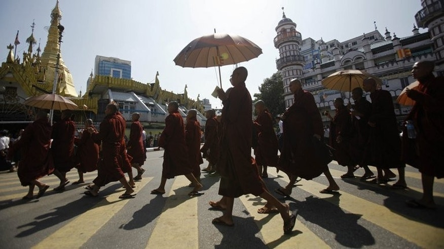 Myanmar Buddhist monks take part in a demonstration against the Organisation of the Islamic Conference in Yangon on October 15, 2012. A small blast near an event hosted by a radical Myanmar monk who stands accused of inflaming Buddhist-Muslim tensions has left five people injured in Mandalay, police said Monday.
