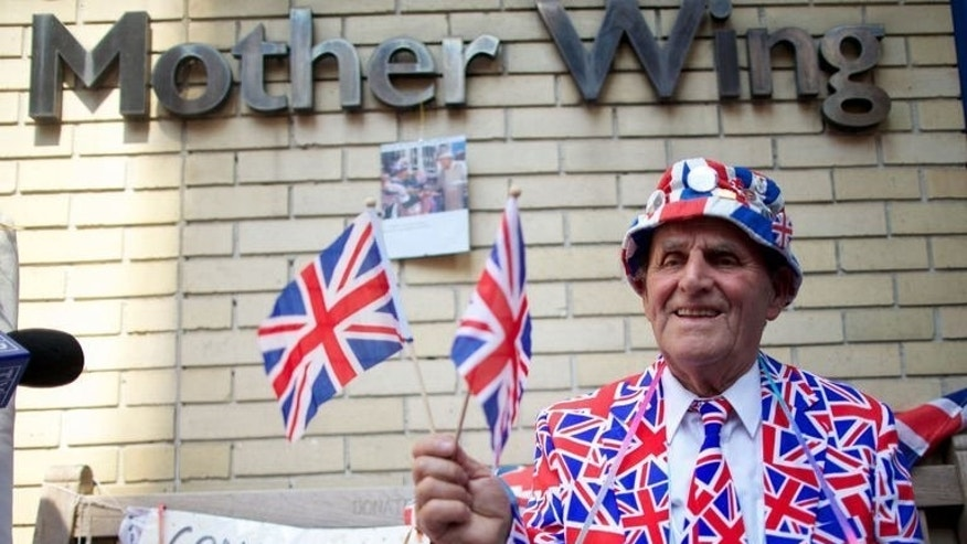 Royal supporter Terry Hutt poses for a picture outside The Lindo Wing of Saint Mary's Hospital in Paddington, west London on July 22, 2013. Britain's royal baby spawned a social media frenzy, but one newspaper's website has installed a 'republican button' to let readers escape the wall-to-wall coverage.